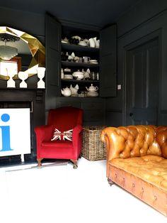 chesterfield couch in a dark interior
