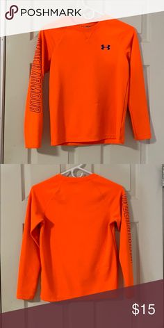 89df4cc069 Under Armour Shirt This is a bright orange long sleeve from Under Armour.  It has