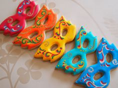 Carnival Mask cookies decorated using flooded royal icing and a little glitter!