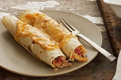 These chicken enchiladas get their Southwest flavor from a mixture of cream cheese and taco seasoning.