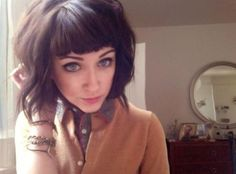 around chin length, razored/textured bob with side swept bangs ...