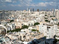 """recognized as a UNESCO World Heritage Site, Tel Aviv's """"White City"""" contains 4,000 International Style buildings, many of which were built in the 1930's and 1940's. To accommodate the influx of Jewish immigrants fleeing Europe, German Bauhaus-trained architects integrated the modern style's affordable and functional building techniques with curved lines and a color well-suited for the Mediterranean climate to create a habitable city by the sea"""