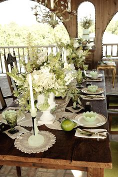 wonderful greenery and white table decor with green glass
