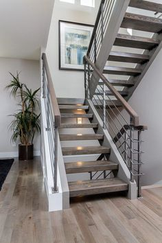 Grey hardwood floors with open staircase & steel railings. like the open stairs Railing Design, Staircase Design, Staircase Ideas, Stair Design, Staircase Remodel, Staircase With Landing, Modern Stairs Design, Staircase Pictures, Staircase Decoration