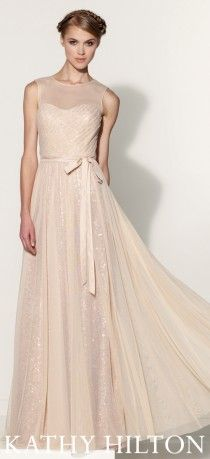 Sleeveless sequin A-line gown with illusion overlay and bateau neckline.