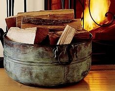 I have a galvanized less expensive tub for my firewood.