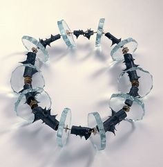 Necklace by Daniel Kruger, 1986. Rose stem segments cast in silver, glass, gold, red rubber.  © By the author.