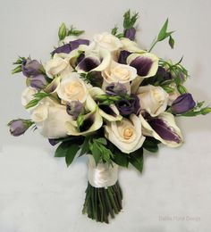 Purple and ivory wedding bouquet - love the tendrils of the lisianthus breaking the line of the bouquet - Created by Dahlia Floral Design