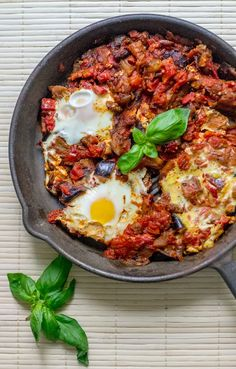 In this traditional Middle Eastern eggplant shakshuka, a thick, chunky tomato and eggplant sauce serves as a bed for perfectly-cooked eggs. Egg Recipes, Cooking Recipes, Healthy Recipes, Healthy Dinners, Delicious Recipes, Recipies, Shakshuka Recipes, Middle Eastern Dishes, Vegan Recipes