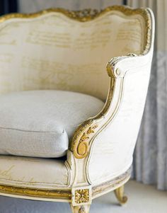 Dana Lyon had Ralph Lauren's Glazed Linen in Sand custom-printed with gold script, to personalize a Louis XVI chair.