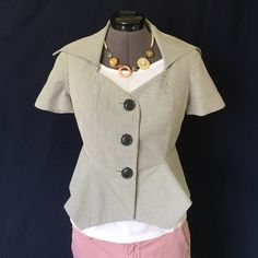 """Elevenses """"Skittering Jacket"""" from Anthro Adorable!!   Perfect for spring! """"Textured dobby stripes highlight the clever seaming on this Elevenses jacket, zigging and zagging along the peplum and accentuating the oh-so-wide collar."""" -Anthro site.  Button closure. Shell is 100% cotton, lining is 65% polyester, 35% cotton. It's a navy and cream stripe. Fully lined. Bust measured flat is approx. 17.5 inches...it does have bust darts so it has a little extra room there. Back of neck to hem is…"""
