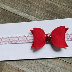 All this warm weather has me thinking of baseball! How sweet is this bow headband?