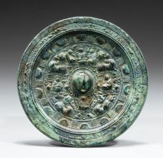 Rare miroir en bronze Chine, dynastie des Han Orientaux, II E siècle ap. J.-C - Sotheby's Oriental, Bronze Mirror, China Art, Antique China, Chinese Antiques, Ancient Art, Archaeology, Metal Working, Modern Art