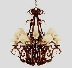 R250-36  NINE LIGHT TWO TIER FORGED IRON CHANDELIER WITH HANDMADE SOLID BRASS LEAVES SHADE: 3 X 7 X 4 SHOWN WITH OPTIONAL ANTIQUE WAX CANDLE...