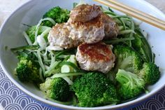 A simple Asian inspired dish of cucumber noodles with peanut sauce topped with pork mince meatballs.