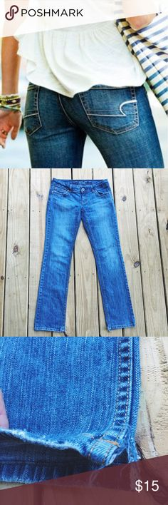 """American Eagle Jeans  These jeans are in very good condition! Straight leg with small slits on the bottom as shown in picture 3. They are also super cute rolled up! :) Inseam 31"""". 99% cotton, 1% spandex so they are a little stretchy. American Eagle Outfitters Jeans Straight Leg"""