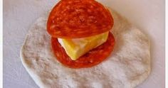 Ingredients 3 cans Pillsbury Buttermilk Biscuits (10 biscuits per can) 56 pepperoni slices Block of cheese (I use Colby & Monterey Jac...