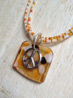 Peace Sign Necklace with Glass Pendant with Orange and White Glass Beads