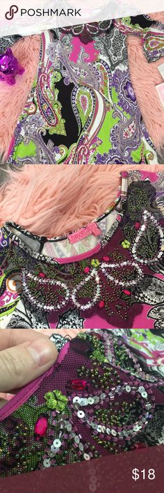 Colorful Paisley Rhinestone Dress Size M 10/12 This is a colorful dress with paisley print and flowy sleeves and bottom. Beautiful on! The collar has beads, gems, and sequins around it. No flaws! Dresses Formal