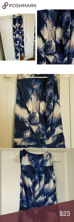 A jumpsuite for every occasion,always well dressed Jumpsuite,can be put in a simple meeting or a more important party.,Blue and white, with delicate ruffled front and zipper ,size xs,never use but I took out the tags attention Other