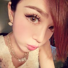 """Gyaru makeup is all about the eyes and typically features winged eyeliner, dramatic false eyelashes and cosmetic colored circle contacts to enhance the size of the iris and give a """"puppy-eyed"""" look.  http://www.eyecandys.com/gyaru-style/"""