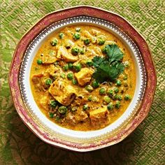 Matar Paneer. Boy, does this look yummy! I made this today in a crockpot. Just threw everything in & kept it simmering for a couple of hours. The only thing I changed was to add 1/2 cup more cream =)