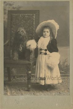 Girl in amazing dress with cute fur dog fantastic antique cabinet photo