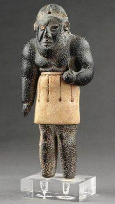 Elamite composite statuette of an anthropomorphic dragon-snake, known as a 'scarface'. This extremely rare type of statuette belongs to the mythology of Central Asia, 3rd millenium BCE. Louvre