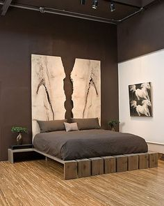 This is a modern bedroom with pizazz. I love the unusual platform bed, the deep brown on the walls. But I am blown away by the headboard, made up of two slabs of stone. Brilliantly conceived and executed. Gorgeous...... V