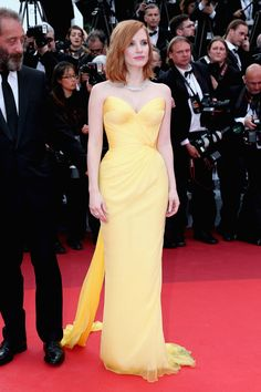 11 May Jessica Chastain made an entrance in a strapless yellow dress.   - HarpersBAZAAR.co.uk