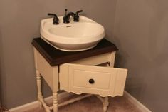 Bathroom sink made from an old sewing machine base.