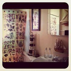 adorable sailor jerry themed bathroom decor. loves it!