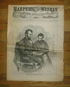 May 6,1865 edition of the popular Harper's Weekly Newspaper chronicling the death and burial events of the Late President. Cover features engraving of Mr. Lincoln and son, Tad copied after Alexander Gardner's photographs of the sitting which would be the final studio portraits taken of the President. *s*