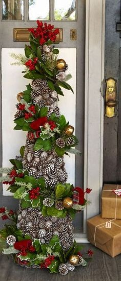 Suzy Homefaker: FRESH PINECONE CRAFTS - how to make a pinecone Christmas tree from an upside down tomato cage, diy Christmas