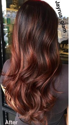 "Cherry bombre hair features red tones woven into brown hair to ""add energy and dimension."":"