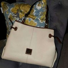 Dooney tote This bag is in mint condition on outside....leather us perfect. Large tote. One small stain inside. Dooney & Bourke Bags Totes