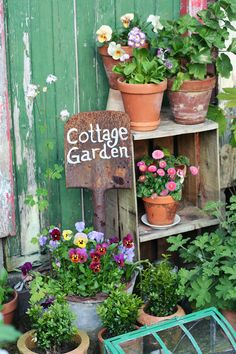 An old door, a crate and some pots and voila!  A cottage garden that fits even the smallest of outdoor spaces.