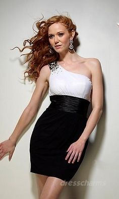 White bodise,black pencil skirt with a high cut, black beading on one shoulder arm strap