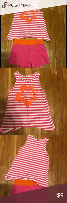Girls Children's Place shorts set Girls size Medium ( 7-8 ). Excellent condition worn a few times before my daughter outgrew it. Striped white & pink tank top with orange design. Solid matching pink shorts with orange waist band Children's Place Matching Sets