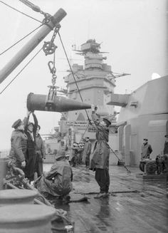 Sailors aboard HMS Rodney receiving a shell from an ammunition ship, Photographer R. Coote Source Imperial War Museum Identification Code A 206 Hms Prince Of Wales, California Beach Camping, Big Guns, Navy Ships, Camping World, Submarines, Aircraft Carrier, Royal Navy, Battleship