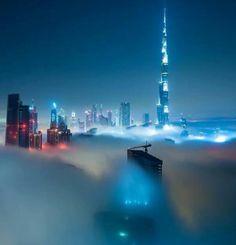 Skyline of Dubai at night under a blanket of fog, UAE.