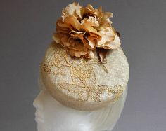 Dutch design made with passion creme percher hat with brown gold and copper lace and ton sur ton flower on comb