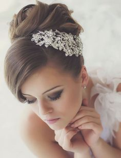 updo wedding hairstyle with classy style; via Websalon Weddings