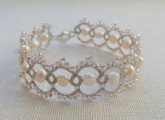 Very beautiful and tender silver bracelet - decorated with freshwater pearls light peach colors and Toho seed beads. Made with shuttle tatting