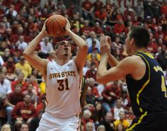 Iowa State's Georges Niang looks for a shot around Michigan's Mitch McGary during the second half at Hilton Coliseum on Sunday, Nov. 17. Photo by Nirmalendu Majumdar/Ames Tribune