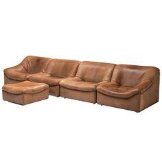 For Sale on - De Sede, sectional sofa with ottoman, cognac buffalo leather, Switzerland, Comfortable four-modular sectional sofa with ottoman in thick buffalo