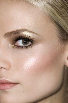 Gold eye makeup and dewy cheeks
