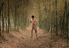 """Children playing Walking on bamboo at the forest. - Children playing """" Walking on bamboo"""" which the ancient skits of Thailand at the forest."""