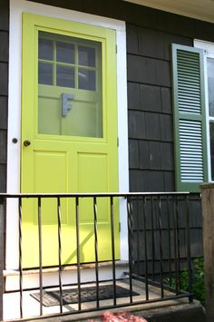 We just had the exterior of our home repainted and we decided to go with a bright chartreuse color (Benjamin Moore's Chamomile) for the front door. Interior Paint Colors, Paint Colors For Home, Front Door Porch, Front Doors, Chartreuse Color, House Doors, Humble Abode, Exterior Paint, House Painting