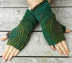This beautiful, textured fingerless mitten pattern is an ode to geometry. The Hexagon Fingerless Mitts are knit in one part starting at the thumb and then increase to form a hexagon shape with lovely ridges that look great in a variegated yarn.